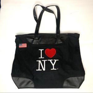 I love New York tote. Black canvas zip opening.